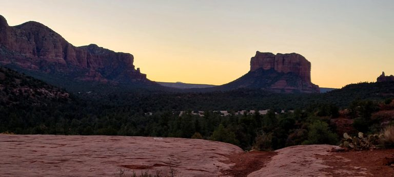 A couple of large rock formations in the sunrise from about half way up the Cathedral Rock Trail