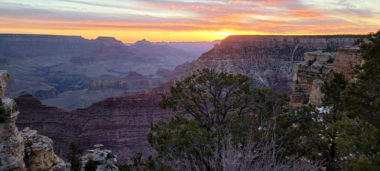The stage right before the sun has fully broke the surface at the Grand Canyon. More of the canyon is now visible.