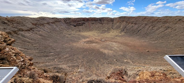 The meteor crater with striated rock running down some 700 feet to the floor of the crater.