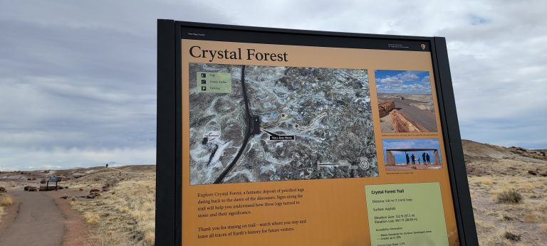 The Sign for the Crystal Forest along with the paved path that takes you to the forest itself.