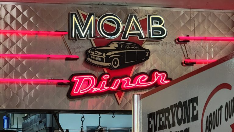 The Neon sign for the Moab Diner hanging in the restaurant