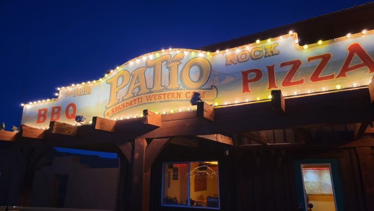 The sign for the Rim Rock Patio is done in an old western style and calls its self a spaghetti western Café with the words BBQ and Pizza highlighted.