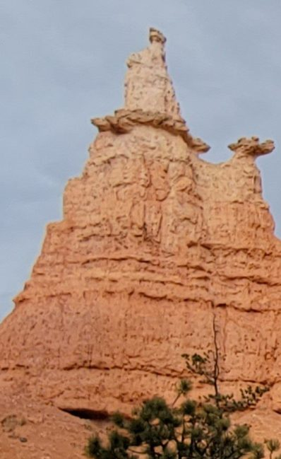 A closer version of the queen on the end of the series of spires.  With imagination you can see a queen holding a book with wide flowing robes and a bit of a crown on the top at the Queen's Garden Loop in Bryce Canyon National Park.