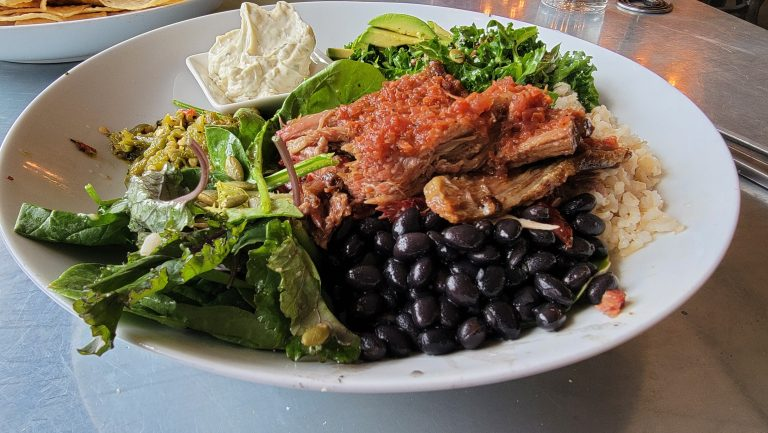 The giant Southwestern Bowl from House Rock Kitchen.  The bowl has black bean, rice, avocado, and greens topped with a healthy portion of smoked brisket.  A good option if you are looking for some Buena Vista Dining.