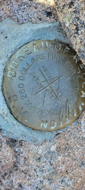 The official medallion at the peak of Mount Flora.