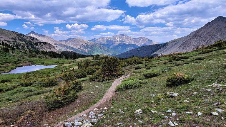 A picture of the Ptarmigan Lake Trail on the way looking back to Mount Harvard one of the Colorado Hiking 14ers.  There is also a small pond on the left side of the photo.