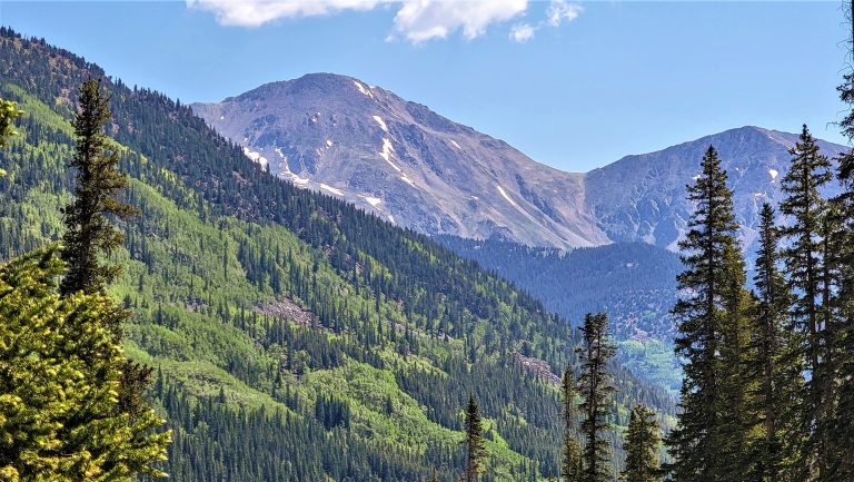 The view from the second rockslide on the Ptarmigan Lake trail is on of a foreground peak covered in trees and what I believe to be Mount Harvard in the back.  Harvard is one of several 14,000 foot peaks that are part of Colorado Hiking.