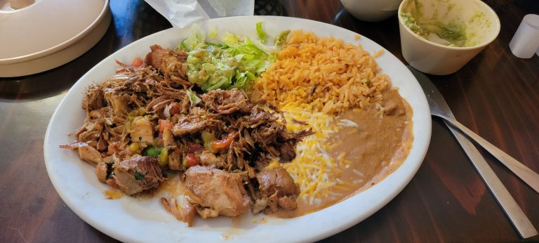 The Carnitas de Puerco from Casa Sanchez in Buena Vista.  The large plate is full with slow cooked pork and rice and beans.