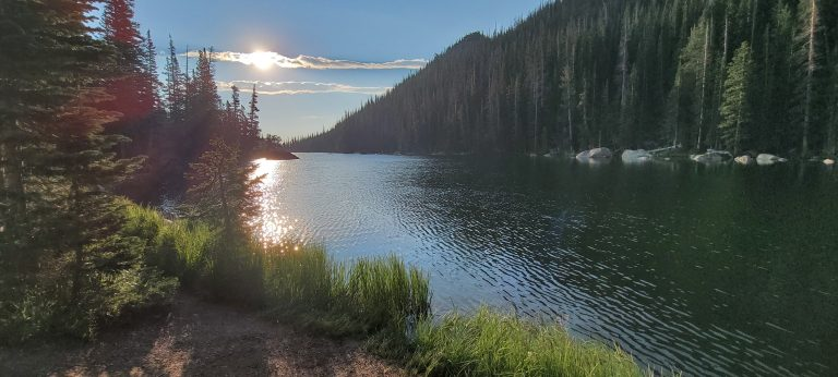 The sun is high and behind a small cloud but still reflecting on Dream Lake. This is the second stop on my Bear Lake Trailhead: Lakes Loop tour.