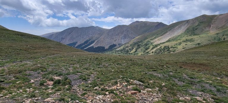 The view back to the start of the French Pass Trail has more defined and much closer mountains.