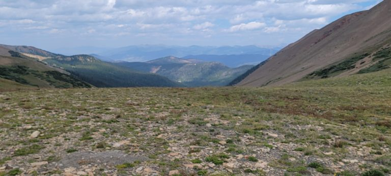 The finish of the French Pass Trail is flat with views of lines of mountains in the distance.
