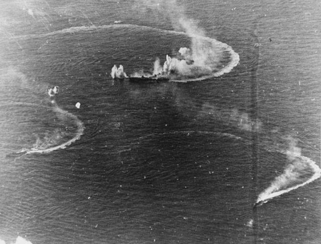 japanese_aircraft_carrier_zuikaku_and_two_destroyers_under_attack
