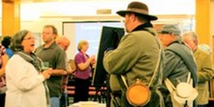 Re-enactors talk with Ruth Voss after a Faulkner County Historical Society meeting