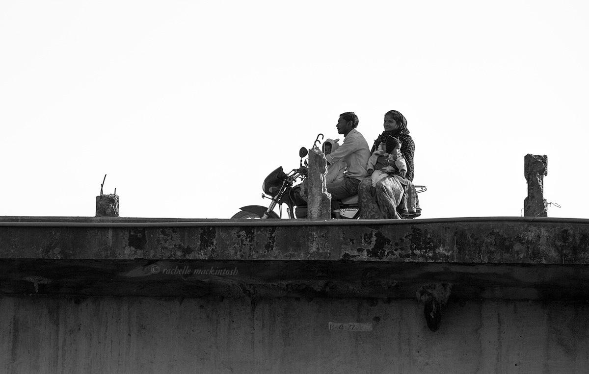 black and white india motorbike family