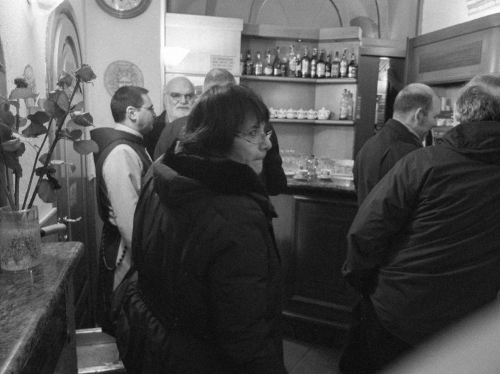 """Priest mingling and having coffee at a bar near Arco del Lauro before """"going to work""""."""