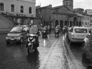 Vespas everywhere! Crossing a street towards the Colosseum.
