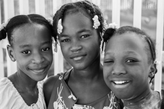 As I waited to cross a street, these girls (on a dare) asked me to take their picture.