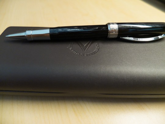 The pen is made of celluloid and it has some color streaks on it.