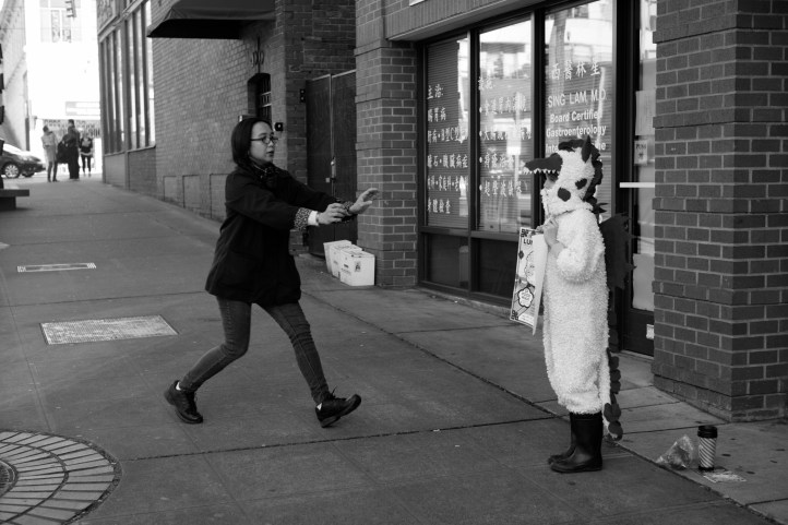 """Mother making sure her kid's dragon costume is """"perfect"""" Leica M-P / Summilux 50mm"""