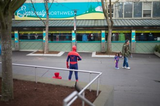 Guy in Spider-Man costume just standing around collecting money for literally doing nothing but pointing to his bucket. Leica M-P / Summilux 50mm