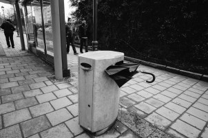 One of several umbrella easting trash cans