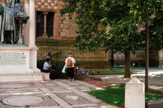 Group smoking weed while a homeless woman sleeps in their presence. Trinity Church, Copley Square