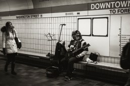 Patriots themed subway musician.