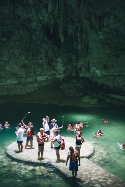 Tourist and their selfie sticks in the cenote