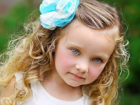 Children long curly hairstyles with accessories
