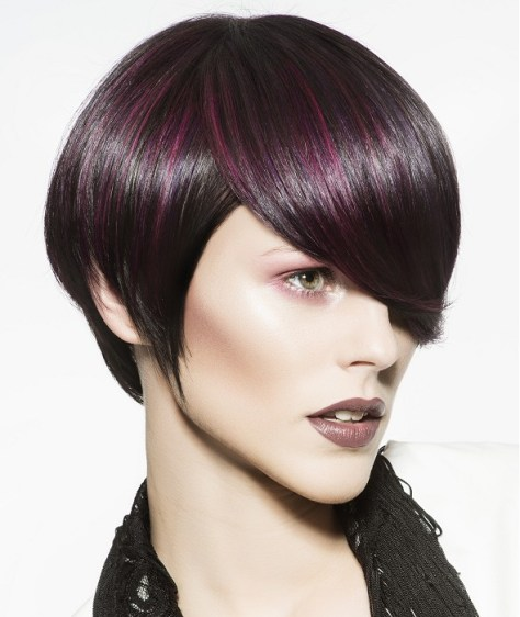 Short round haircut with a long fringe covering the eyebrows.