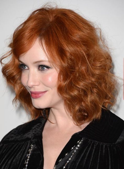 Fashionable mussed and tousled wavy hairstyle.