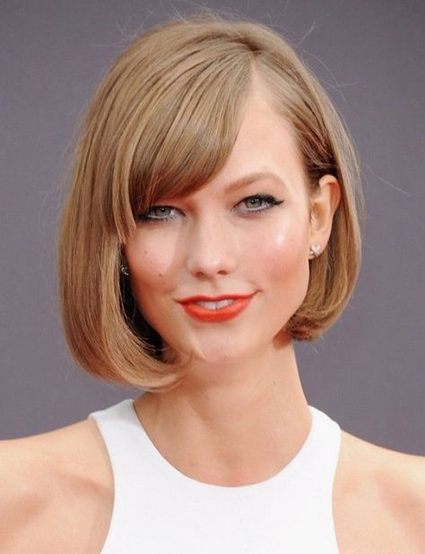 Short haircut styled straight with a curve inward.