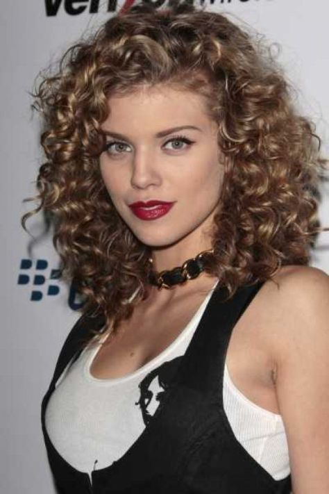 Long brunette hair with spiral curls around the shoulders