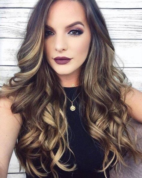33 Lush rolling long hair with an off center part
