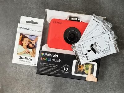 Quickly take photos with a Polaroid for a Bridal Shower Game | FaveMom