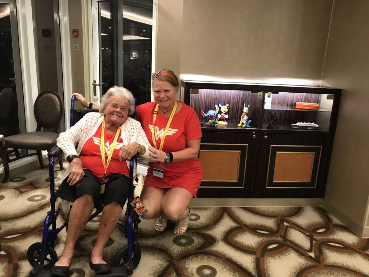 Ellen and her Mom on the cruise ship posing in wonder woman t-shirts
