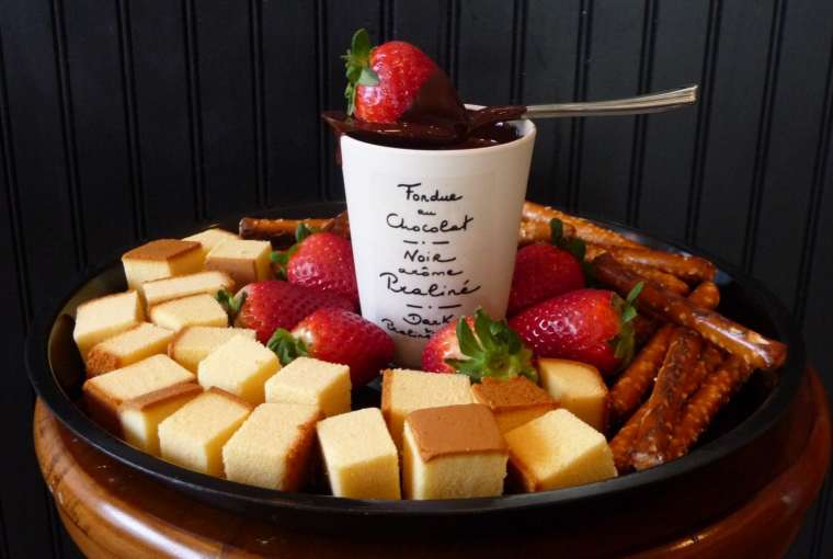 chocolate fondue with pound cake and strawberrires