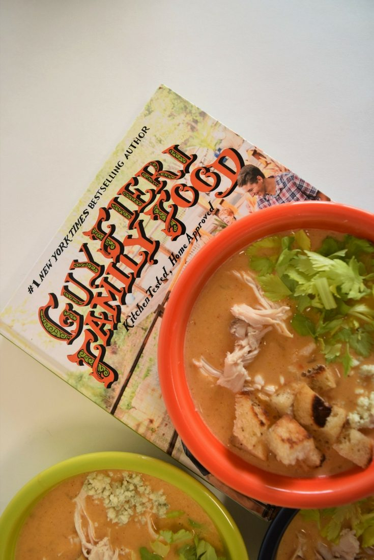 Guy Fieri's Buffalo Chicken Soup recipe atop the cook book of the name Guy Fieri Family Food