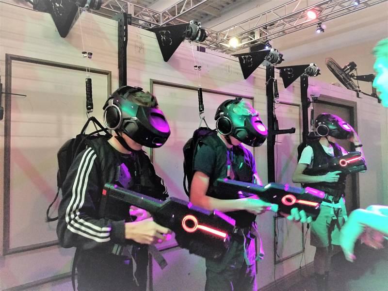 3 boys in virtual reality headgear