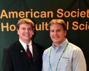 Dave Kopsell (left) and Dean Kopsell (right) attend an American Society of Horticultural Sciences meeting.