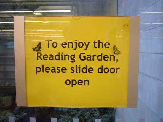 Sign on window: To enjoy the Reading Garden, please slide door open