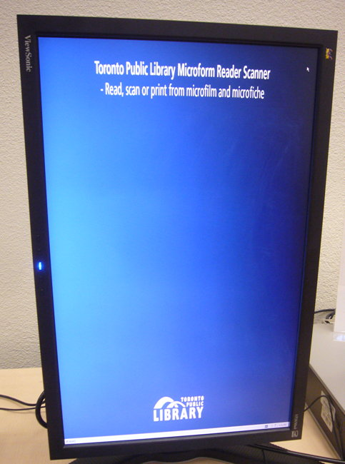 Vertical monitor has two lines of scrunched white type at the top amid a sea of blue