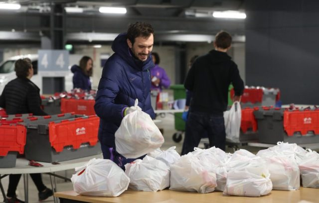 Tottenham Hotspur players and coaches offer their services at stadium food hub