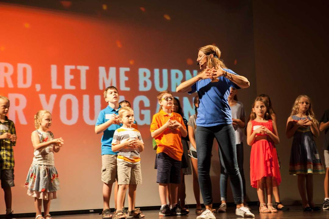 Leader with children during worship
