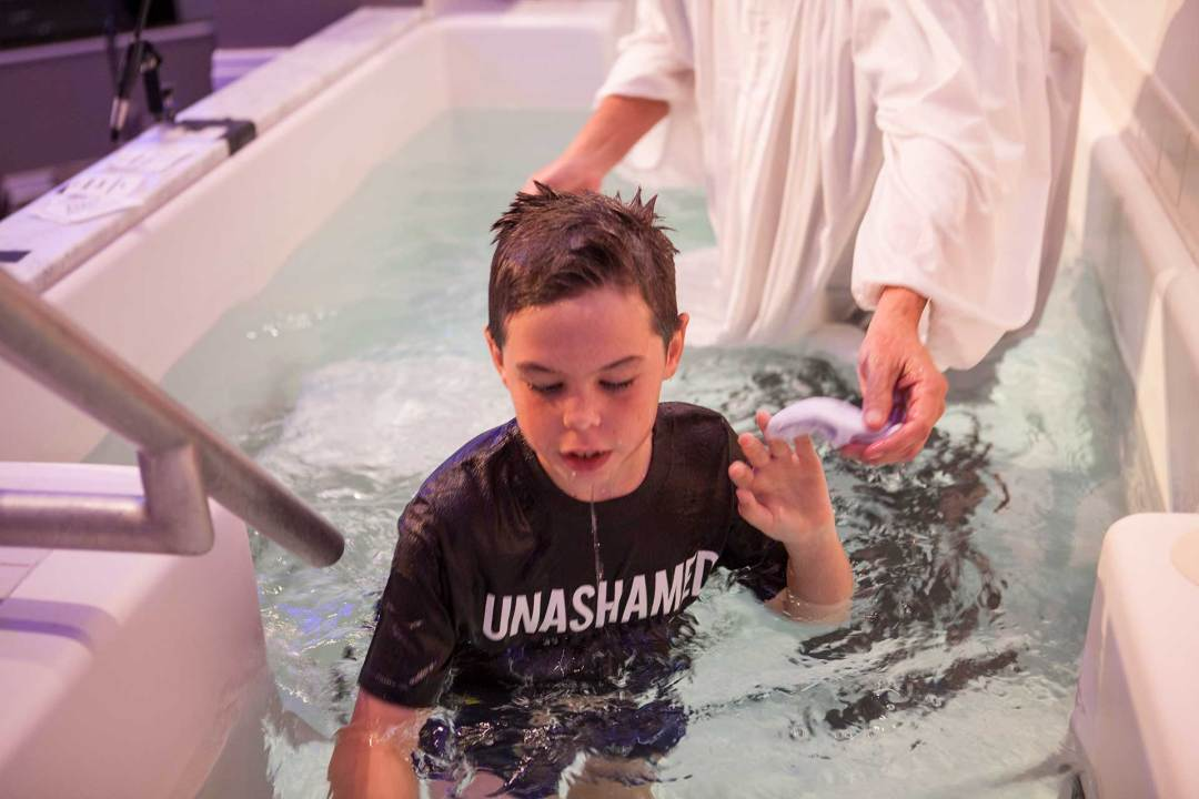 boy getting out of baptism