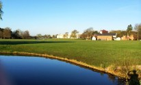 A beautiful morning view of the lake and playing fields of Sandhurst. Old College and New College stand in the foreground.