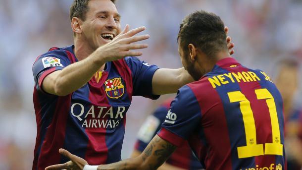 Barcelona's Lionel Messi, left celebrates with teammate Neymar after scoring during a Spanish La Liga soccer match between Real Madrid and Barcelona at the Santiago Bernabeu stadium in Madrid, Spain, Saturday Oct. 25, 2014. (AP Photo/Paul White)