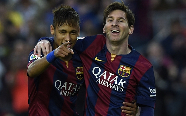 TOPSHOTS Barcelona's Brazilian forward Neymar da Silva Santos Junior (L) and Barcelona's Argentinian forward Lionel Messi (R) celebrate after scoring a goal during the Spanish league football match FC Barcelona vs Getafe at the Camp Nou stadium in Barcelona on April 28, 2015. AFP PHOTO/ LLUIS GENELLUIS GENE/AFP/Getty Images