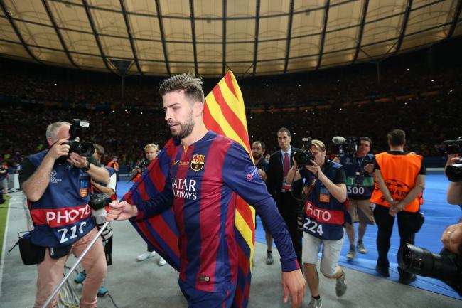 Who will partner Barcelona centre-back Gerard Pique?