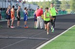 During the 4x800 relay, junior Connor Sturgeon passes the baton to senior Parker Bussabarger-Davidenkoff.